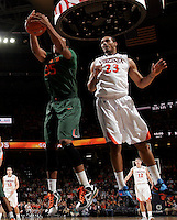 CHARLOTTESVILLE, VA- JANUARY 7: Kenny Kadji #35 of the Miami Hurricanes grabs a rebound next to Mike Scott #23 of the Virginia Cavaliers during the game on January 7, 2012 at the John Paul Jones Arena in Charlottesville, Virginia. Virginia defeated Miami 52-51. (Photo by Andrew Shurtleff/Getty Images) *** Local Caption *** Mike Scott;Kenny Kadji