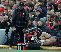 27th October 2019; Anfield, Liverpool, Merseyside, England; English Premier League Football, Liverpool versus Tottenham Hotspur; Liverpool manager Jurgen Klopp speaks with his assistant coaches Peter Krawietz  Pepijn Lijnders - Strictly Editorial Use Only. No use with unauthorized audio, video, data, fixture lists, club/league logos or 'live' services. Online in-match use limited to 120 images, no video emulation. No use in betting, games or single club/league/player publications