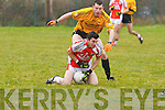 Brosna's Tom McGoldrick being forced to the ground by Listowel Emmets' Micheal Murphy.