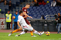Calcio, Serie A: Roma vs Palermo. Roma, stadio Olimpico, 23 ottobre 2016.<br /> Roma's Edin Dzeko is challenged by Palermo's Edoardo Goldaniga, foreground, during the Italian Serie A football match between Roma and Palermo at Rome's Olympic stadium, 23 October 2016. Roma won 4-1.<br /> UPDATE IMAGES PRESS/Riccardo De Luca