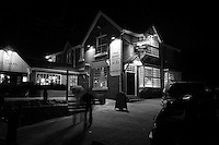 Pub at nightime black and white