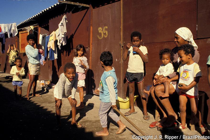 Rio de Janeiro favela daily life, Brazil. Children play, families enjoy sunny day.