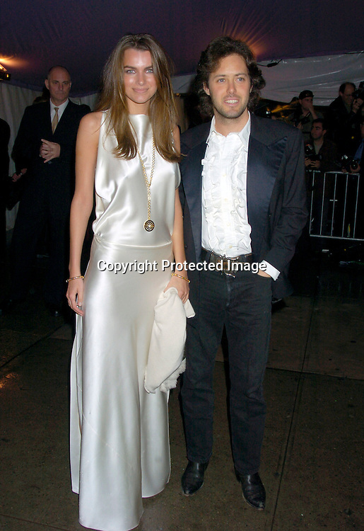 David Lauren and date..at The Costume Institute Gala of the Metropolitan Museum of Art on April 26, 2004 ...Photo by Robin Platzer, Twin Images