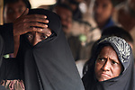 Rohingya women wait in line for tarps and blankets provided by Christian Aid, a member of the ACT Alliance, in the Jamtoli Refugee Camp near Cox's Bazar, Bangladesh.<br /> <br /> More than 600,000 Rohingya have fled government-sanctioned violence in Myanmar for safety in Bangladesh.