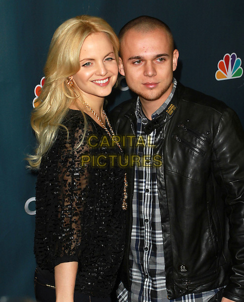 "MENA SUVARI & SIMONE SESTITO.Premiere Party for ""The Cape"" held At The Music Box Theatre, Hollywood, CA, USA, 4th January 2010..half length black lace top gold necklace trousers couple married husband wife leather jacket .CAP/ADM/KB.©Kevan Brooks/AdMedia/Capital Pictures."