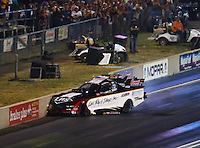Jul 23, 2016; Morrison, CO, USA; NHRA funny car driver Tim Wilkerson crashes into the wall during qualifying for the Mile High Nationals at Bandimere Speedway. Mandatory Credit: Mark J. Rebilas-USA TODAY Sports