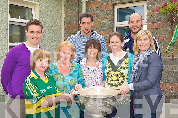 Staff of Lyrecompane NS meet Kerry stars Tadgh Kennelly, Anthony Maher and Kieran Quirke and the Sam Maguire on Thursday l-r: Bernie Faulkner, Mary Leen, Martina Culloty, Marguerite Cahill and Ciara O'Connor