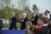 Arlington, VA - September 11, 2008 -- United States President George W. Bush, Secretary of Defense Robert M. Gates Donald Rumsfeld, former secretary of defense, stand as the national anthem plays at the Pentagon Memorial dedication ceremony Sept. 11, 2008. The national memorial is the first to be dedicated to those killed at the Pentagon on Sept. 11, 2001. The site contains 184 inscribed memorial units honoring the 59 people aboard American Airlines Flight 77 and the 125 in the building who lost their lives that day..Credit: Jerry Morrison - DoD via CNP