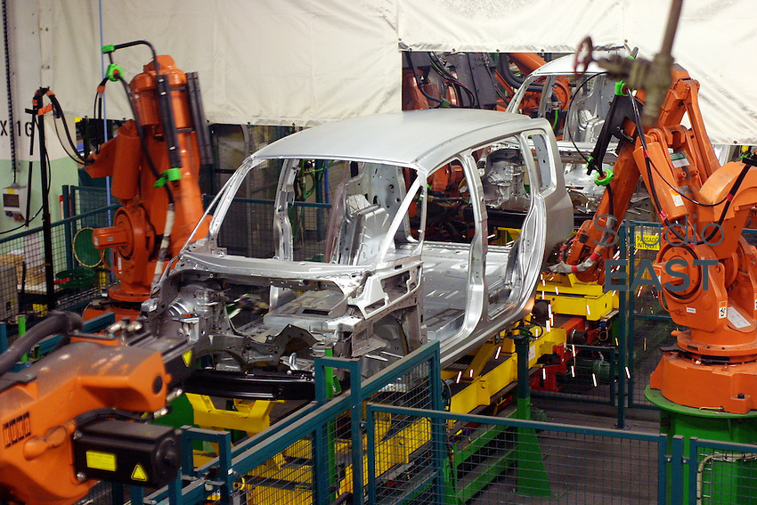 Robots weld the body of a Renault Espace IV car, in Renault plant, in Sandouville, France, on September 18, 2002. Photo by Lucas Schifres/Pictobank