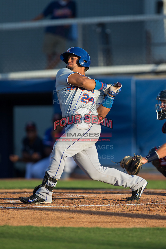 Jose Maria (24) of the Kingsport Mets follows through on his swing against the Danville Braves at American Legion Post 325 Field on July 9, 2016 in Danville, Virginia.  The Mets defeated the Braves 10-8.  (Brian Westerholt/Four Seam Images)