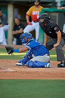 Keibert Ruiz (33) of the Oklahoma City Dodgers in front of home plate umpire Jonathan Parra during a game against the Salt Lake Bees at Smith's Ballpark on August 1, 2019 in Salt Lake City, Utah. The Bees defeated the Dodgers 14-4. (Stephen Smith/Four Seam Images)