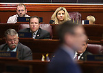 Nevada Assemblywoman Michele Fiore sits with Ammon Bundy, left, and his son Hayden, 10, during a speech from Republican Rep. Joe Heck at the Legislative Building in Carson City, Nev., on Monday, March 30, 2015. <br /> Photo by Cathleen Allison