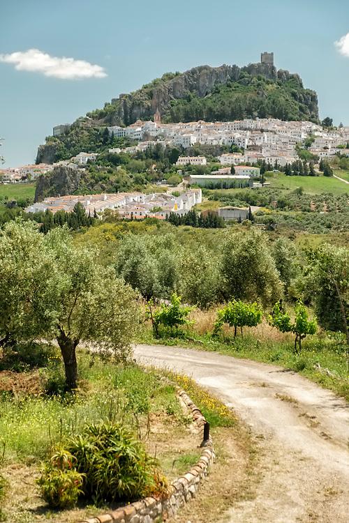 Under a Moorish castle, the white hill town of Zahara de la Sierra basks in the morning sun.
