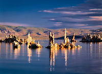 Reflection of tall, thin tufa in Mono Lake. California.