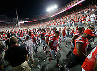 The Ohio State Buckeyes walk off the field after the college football game between the Ohio State Buckeyes and the Virginia Tech Hokies at Ohio Stadium in Columbus, Saturday afternoon, September 6, 2014. The Virginia Tech Hokies defeated the Ohio State Buckeyes 35 - 21. (The Columbus Dispatch / Eamon Queeney)