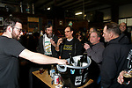 Oxford CT-011919MK11 Stephen Andrews, from Fox Farm Brewery, serves a sample to (from left Ed Brease, Bill Hemenway,Tom Eckels and John Luckey at Black Hog Brewing Co. in Oxford. The event featured 26 breweries from all over New England along with artisan snack vendors and food trucks.   Marissa Leone, vent coordinator said that they hoped to raise over $3000 to benefit The Connecticut Children's Medical Center. Michael Kabelka / Republican American