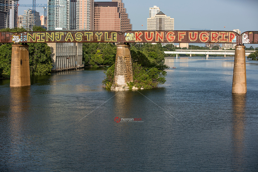 The Austin Railroad Graffiti Bridge over Lady Bird Town Lake contains beloved and inspiring graffiti paintings in downtown Austin, Texas.