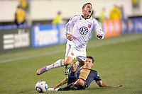 Santino Quaranta (25) of D. C. United is fouled by Shea Salinas (11) of the Philadelphia Union. The Philadelphia Union defeated D. C. United 3-2 during a Major League Soccer (MLS) match at Lincoln Financial Field in Philadelphia, PA, on April 10, 2010.