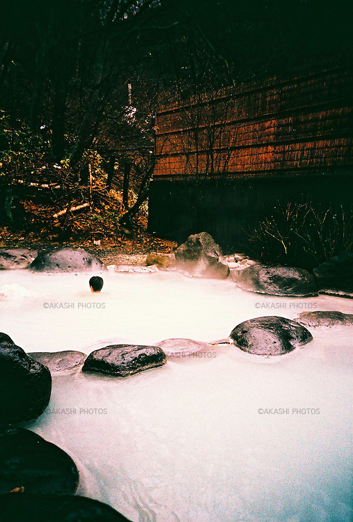 Japanese man takes a bath in Hakkodasan Onsen, Aomori, Japan...