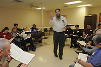 NWA Democrat-Gazette/FLIP PUTTHOFF <br /> Andrew Albers leads the singing Saturday, Oct. 24 2015 during the Sacred Harp Singing Convention in Springdale. Singers from the area and surrounding states attended the event, hosted by the Shiloh Singers.