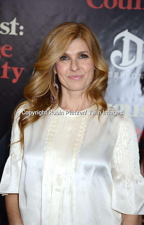 "Connie Britton attends the New York Premiere of ""August: Osage County"" on December 12, 2013 at the Ziegfeld Theatre in New York City."