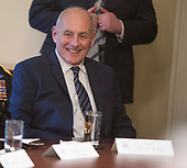 White House Chief of Staff John Kelly listens to President Donald J. Trump make statements on the ongoing investigation of  election meddling and on the current situation in Syria during a meeting with senior military leadership at The White House in Washington, DC, March 9, 2018. Credit: Chris Kleponis / CNP