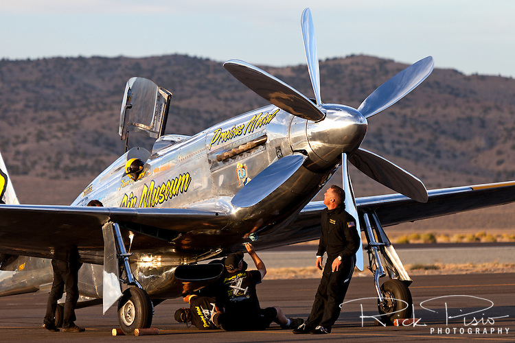 The Precious Metal crew tend to the P-51 Mustang Unlimited Air Racer during the 2012 Reno National Championship Air Races