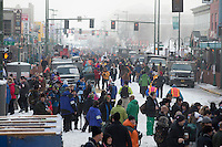 4th Avenue is jammed with people and dog trucks prior to the ceremonial start of the Iditarod sled dog race in downtown Anchorage Saturday, March 2, 2013. ..Photo (C) Jeff Schultz/IditarodPhotos.com  Do not reproduce without permission