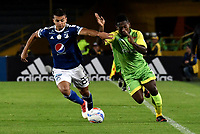 BOGOTA - COLOMBIA - 25 – 03 - 2018: Jhon Duque (Izq.) jugador de Millonarios disputa el balón con Pablo Rojas (Der.) jugador de Jaguares F. C., durante partido de la fecha 10 entre Millonarios y Jaguares F. C., por la Liga Aguila I 2018, jugado en el estadio Nemesio Camacho El Campin de la ciudad de Bogota. / Jhon Duque (L) player of Millonarios vies for the ball with Pablo Rojas (R) player of Jaguares F. C., during a match of the 10th date between Millonarios and Jaguares F. C., for the Liga Aguila I 2018 played at the Nemesio Camacho El Campin Stadium in Bogota city, Photo: VizzorImage / Luis Ramirez / Staff.