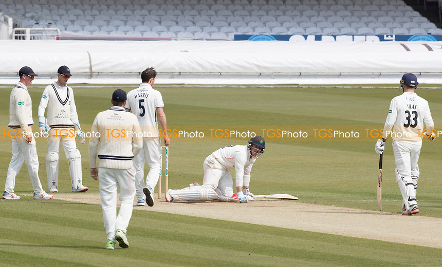 The players quickly look to Rob Jones of Lancashire CCC after he is felled by a short delivery from James Harris during Middlesex CCC vs Lancashire CCC, Specsavers County Championship Division 2 Cricket at Lord's Cricket Ground on 13th April 2019