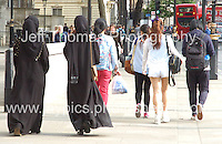 Worlds apart. The Muslim dress and those in the British Summer fashion<br /> <br /> <br /> Photo credit: Jeff Thomas - Jeff Thomas Photography - 07837 386244/07837 216676 - www.jaypics.photoshelter.com - thomastwotimes@live.co.uk
