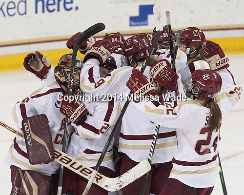 The Eagles celebrate their win. - The Boston College Eagles defeated the visiting Boston University Terriers 3-2 on Friday, February 22, 2014, at Kelley Rink in Conte Forum in Chestnut Hill, Massachusetts.