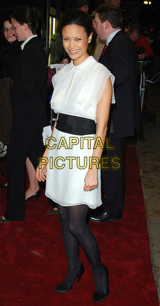 """THANDIE NEWTON.Attends the UK Film Premiere of """"The Pursuit of Happyness"""", Curzon  Mayfair Cinema, London, England, 8th January 2007..full length white dress collar black waist band belr tights shoes.CAP/CAN.©Can Nguyen/Capital Pictures"""