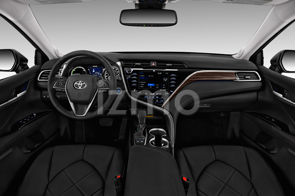 Stock photo of straight dashboard view of a 2018 Toyota Camry XLE Hybrid 4 Door Sedan