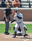 Baltimore, MD - April 9, 2009 -- New York Yankee first baseman Mark Teixeira (25) watches the flight of the ball in the first inning against the Baltimore Orioles at Oriole Park at Camden Yards in Baltimore, MD on Thursday, April 9, 2009..Credit: Ron Sachs / CNP.(RESTRICTION: NO New York or New Jersey Newspapers or newspapers within a 75 mile radius of New York City)