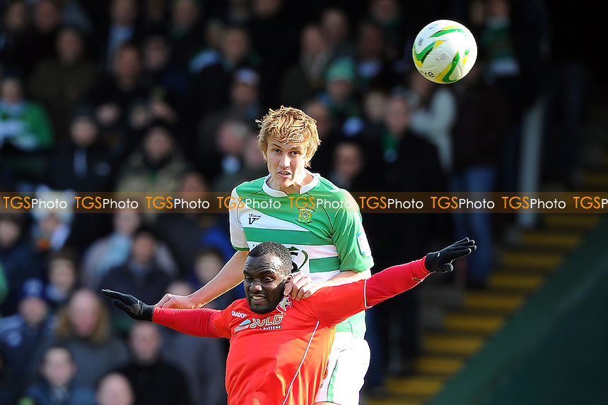 Dan Burn of Yeovil Town beats Craig Westcarr of Walsall - Yeovil Town vs Walsall - NPower League One Football at Huish Park, Yeovil, Somerset - 29/03/13 - MANDATORY CREDIT: Denis Murphy/TGSPHOTO - Self billing applies where appropriate - 0845 094 6026 - contact@tgsphoto.co.uk - NO UNPAID USE.