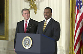 United States Representative J.C. Watts (Republican of Oklahoma), right, introduces US President George W. Bush, left, who will make remarks to African-American leaders in the East Room of the White House in Washington, DC on March 29, 2001.<br /> Credit: Ron Sachs / CNP