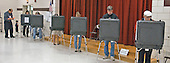 Voting is underway at Oakland Terrace Elementary School in Silver Spring, Maryland on November 2, 2004.  They were choosing between Democratic United States Senator John F. Kerry (Democrat of Massachusetts) and Republican United States President George W. Bush to lead America for the next four years.  Additionally, United States Senator Barbara Mikulski (Democrat of Maryland) and United States Representative Chris Van Hollen (Democrat of Maryland) are standing for re-election.  Although Maryland is traditionally a Democratic state, there has been talk of the Republicans gaining strength after the election of Governor Robert Ehrlich, the first Republican Governor in 34 years in 2002.  At Oakland Terrace there was no Republican precinct workers or signs.  Also on the ballot are referendums on term limits for Montgomery County (Maryland) council members, a cap on property tax rates, and a change in the way council members are selected..Credit: Ron Sachs / CNP