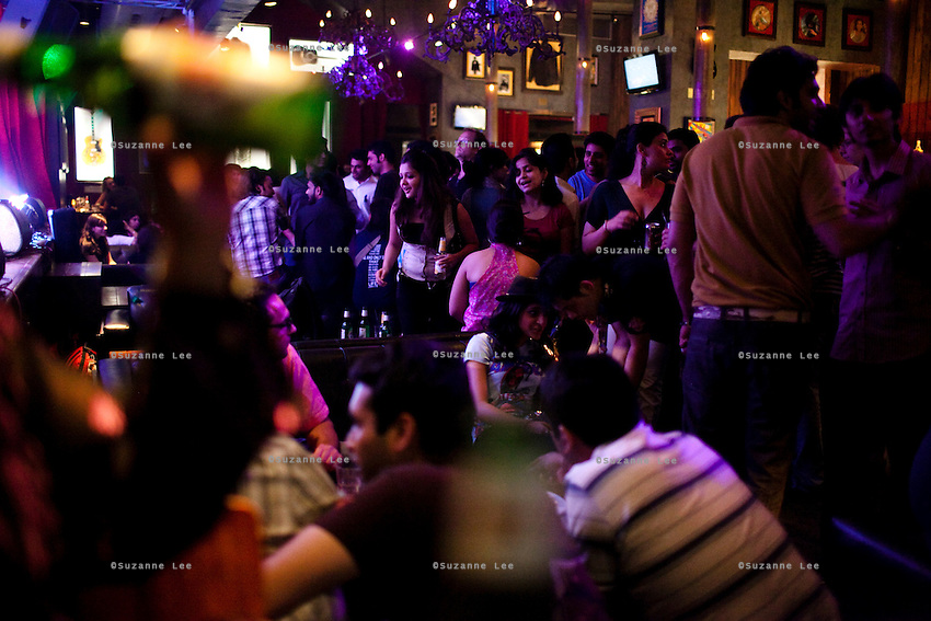 Youth hang out and party at Advaita's performance in Hard Rock Cafe, Saket, in New Delhi, India. Photo by Suzanne Lee