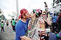 Mardi Gras revelers kiss, 2014