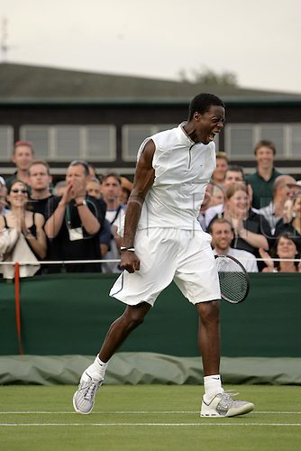 20 June 2005: French player Gael Monfils (FRA) shows his aggression during the first round of the men's singles against Okun at Wimbledon. Monfils won 3-6 6-4 6-4 7-6 (16-14) Photo: Steve Bardens/Actionplus....050620 tennis championships  player men men's mens day one 1 aggressive determination anger angry.