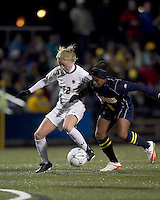 "Boston College midfielder Julia Bouchelle (12) attempts to control the ball as West Virginia midfielder Ashtin Larkin (5) pressures. Boston College defeated West Virginia, 4-0, in NCAA tournament ""Sweet 16"" match at Newton Soccer Field, Newton, MA."