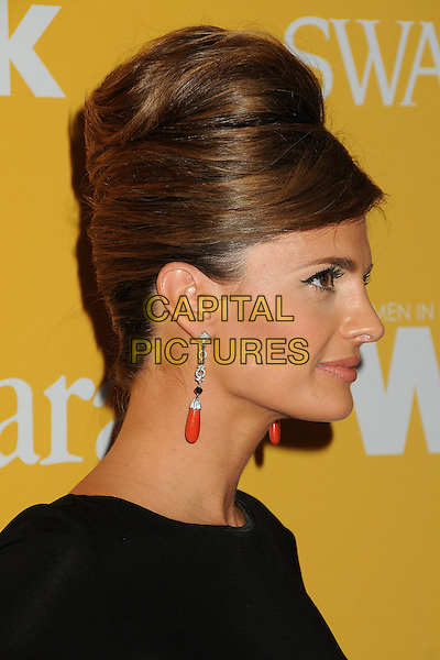 Stana Katic.Women In Film Crystal + Lucy Awards 2012 held at the Beverly Hilton Hotel, Beverly Hills, California, USA..June 12th, 2012.headshot portrait black hair up beehive dangling silver red earrings profile .CAP/ADM/BP.©Byron Purvis/AdMedia/Capital Pictures.