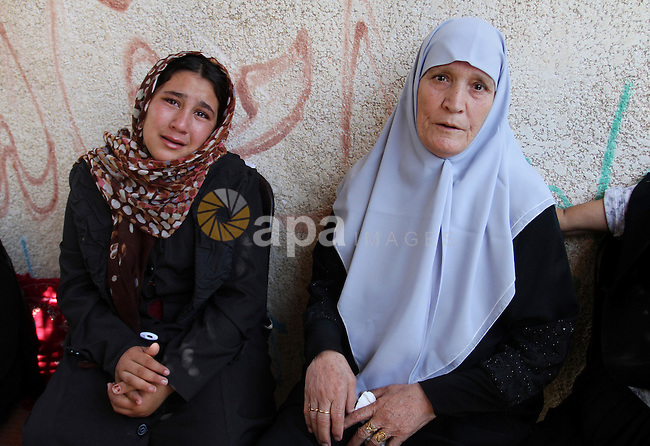 "Palestinian relatives and friends mourn during the funeral of Salah al-Astal, a member of the Islamic Jihad's armed wing -the Al-Quds Brigades- who died after a tunnel collapse in the Gaza Strip, on July 19, 2016 in Khan Younis in the southern Gaza Strip. The Al-Quds Brigades announced in a statement that Salah al-Astal had died during the ""collapse of a resistance tunnel,"" a term used by Islamic Jihad, Hamas and other Palestinian militant factions to refer to tunnels used in the conflict with Israel. Since January 26, at least 14 Gazans have been killed in at least seven separate tunnel collapses. Photo by Abed Rahim Khatib"