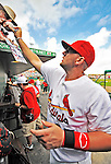 8 March 2012: St. Louis Cardinals' first baseman Matt Adams signs autographs prior to a Spring Training game against the Boston Red Sox at Roger Dean Stadium in Jupiter, Florida. The Cardinals defeated the Red Sox 9-3 in Grapefruit League action. Mandatory Credit: Ed Wolfstein Photo