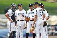 West Michigan Michigan Whitecaps (LtoR) Drew Longley, Josh Lester, Eudis Idrogo, Blaise Salter, Daniel Pinero, and Anthony Pereira wait for the coach to arrive at the mound against the Fort Wayne TinCaps during the Midwest League baseball game on April 26, 2017 at Fifth Third Ballpark in Comstock Park, Michigan. West Michigan defeated Fort Wayne 8-2. (Andrew Woolley/Four Seam Images via AP Images)