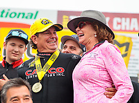 Aug 19, 2018; Brainerd, MN, USA; NHRA top fuel driver Billy Torrence celebrates with wife Kay Torrence after winning the Lucas Oil Nationals at Brainerd International Raceway. Mandatory Credit: Mark J. Rebilas-USA TODAY Sports