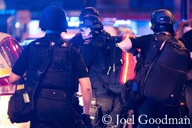 © Joel Goodman - 07973 332324 . 22/05/2017. Manchester, UK. Armed police arrive and head towards Victoria Station . Police and other emergency services are seen near the Manchester Arena after reports of an explosion. Police have confirmed they are responding to an incident during an Ariana Grande concert at the venue. Photo credit : Joel Goodman