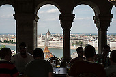 The Hungarian Parliament building in Pest, seen from a bar on the Buda side of the Danube, Budapest.
