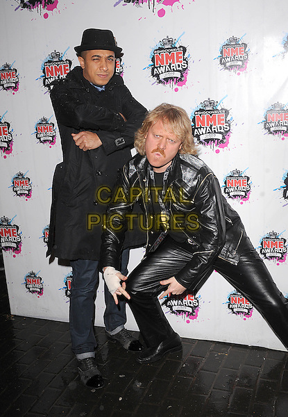 JADE JONES & LEIGH FRANCIS.The Shockwaves NME Awards 2010 held at Brixton Academy, London, England..February 24th, 2010.full length black hat jacket leather trenchcoat trench coat arms crossed bending leaning funny.CAP/BEL.©Tom Belcher/Capital Pictures.